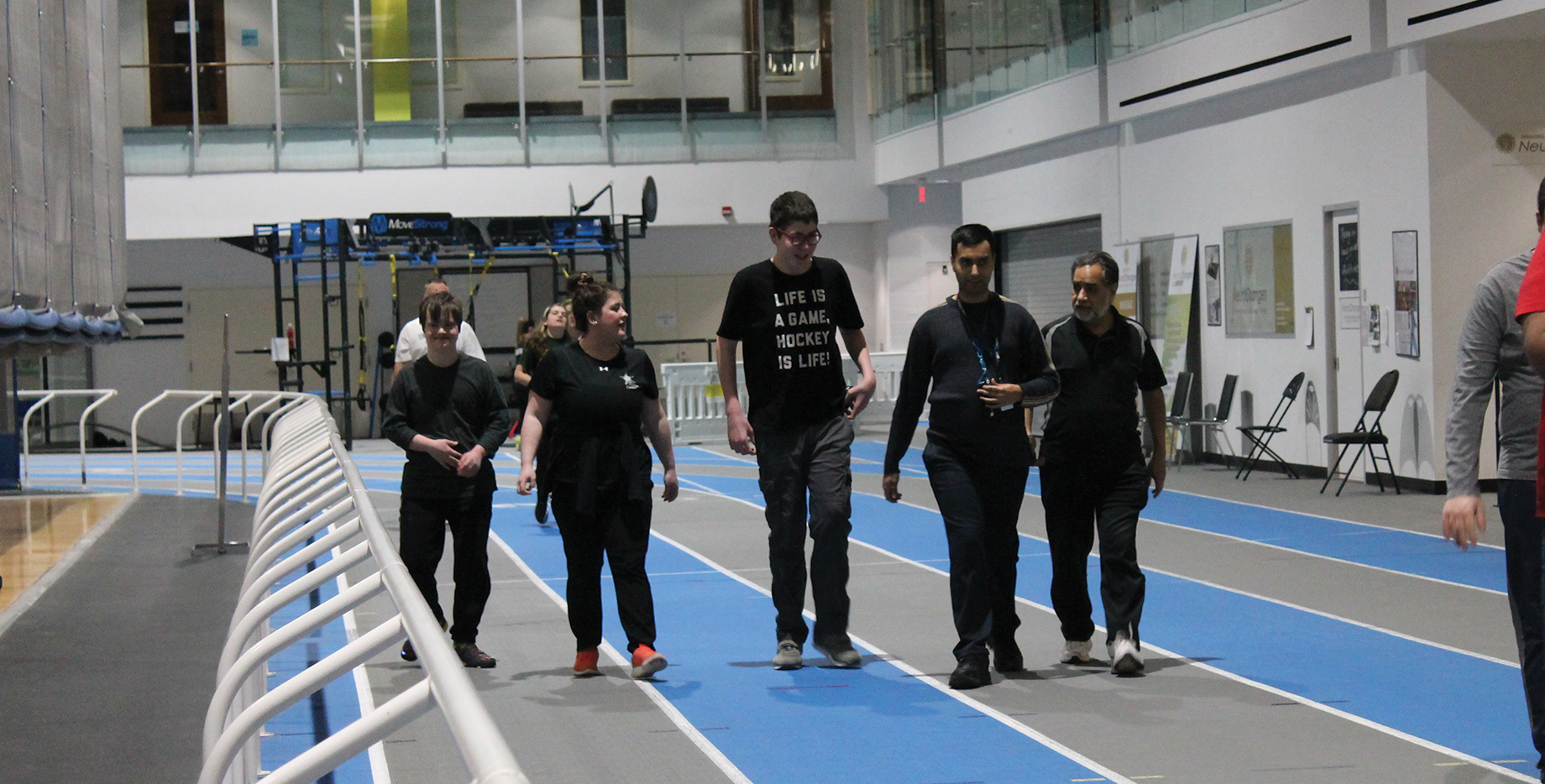 Members walking on Abilities Centre track inside the Fieldhouse