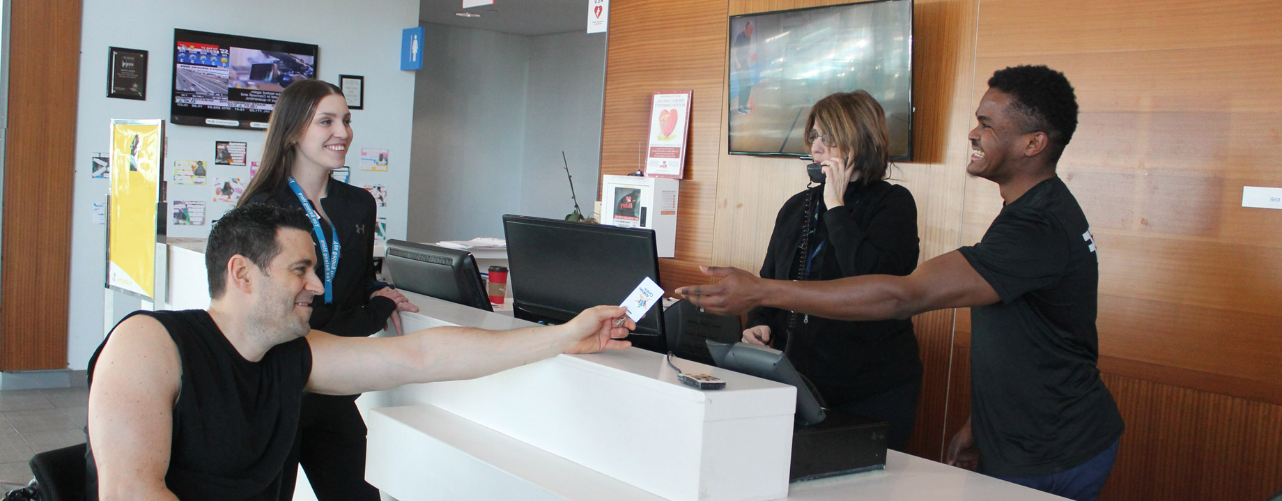Member greeted by friendly Abilities Centre front desk staff