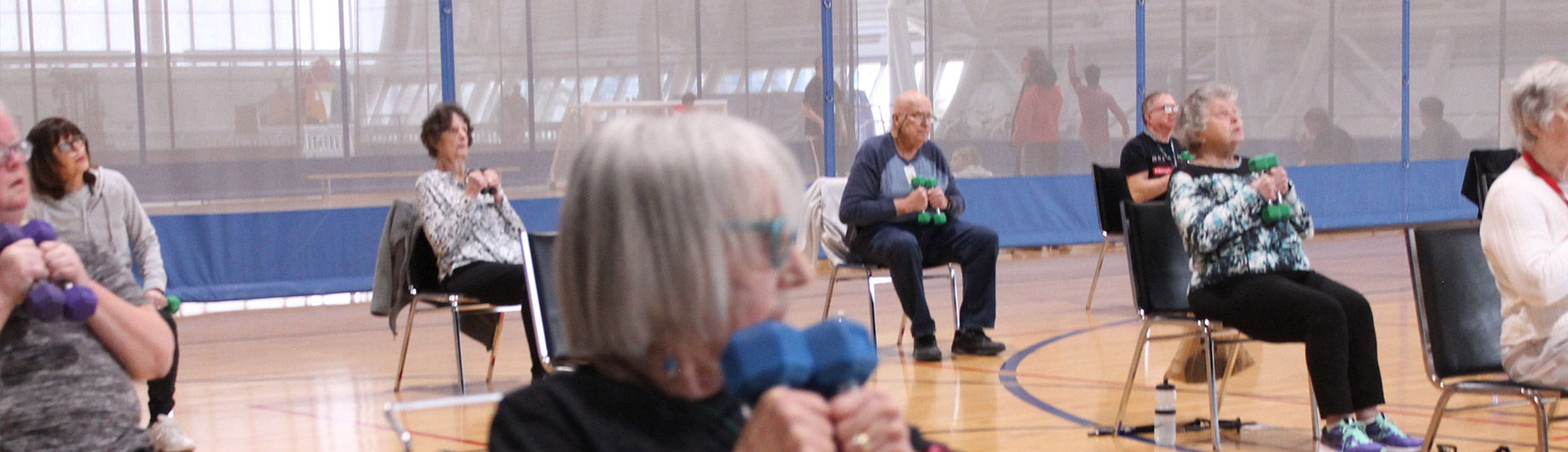 Various aged members exercising with dumbbells at Abilities Centre