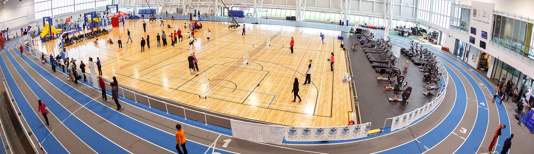 Multiple games being played by all ages on 3 Abilities Centre courts in Fieldhouse