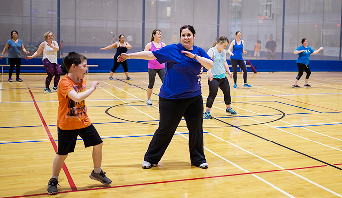 You and adult members exercising on court at Abilities Centre