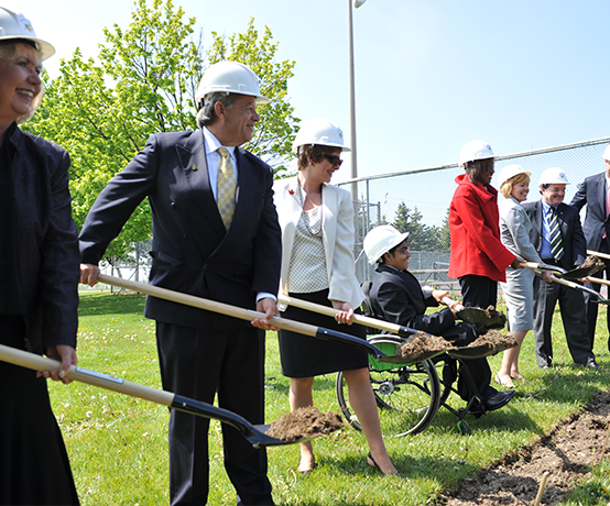 A group of founding community individuals holding shovels at Abilities Centre groundbreaking