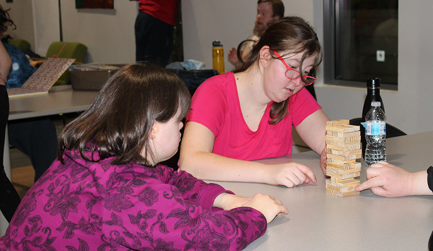 Two female Therapeutic Rec participants enjoy program participation through the use of games